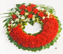 Red Carnation Wreath Code: JGFF2960RCW | Local Delivery Or Collect From Shop Only