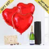 A delicious bottle of bubbly Champagne with Three Fun Plain Helium Red Heart Balloons and Luxury Chocolates Code: JGFV854PRBCC