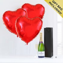 A delicious bottle of bubbly Champagne with Three Fun Plain Helium Red Heart Balloons Code: JGFV855PRBC Local Delivery Only