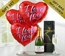 "A delicious bottle of bubbly Champagne with Three Fun Helium Red Heart ""I Love You"" Balloons Code: JGFV965ILYRBC"