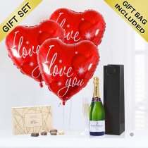 A delicious bottle of bubbly Champagne with Three Helium Red Heart I Love You Balloons and Luxury Chocolates Code: JGFV74ILYRBCC
