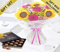 Hot Pink Sunflower Hand tied with a Box Of Luxury Milk Chocolate Truffles Code: JGFSFH60432CT