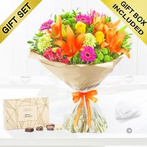 Get well vibrant hand tied with a box of Belgian chocolates Code: JGFG20381GVHC | Local delivery or collect from shop only