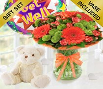 Get Well Vibrant Orange Zest Vase with a Cuddly Soft Bailey Bear and a Fun Helium Get Well Balloon Code: JGF023545VOGWTB | Local Delivery Only