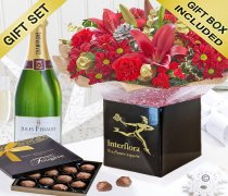 Christmas Cracker Hand-tied with a delicious bottle of bubbly Champagne and a Box Of Luxury Chocolate Truffles Code: JGFX80051RSTCHT