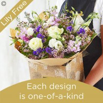 Lily Free Florists Choice Hand tied bouquet made with seasonal flowers Code: LFHT4S | National Delivery and Local Delivery Or Collect From Shop