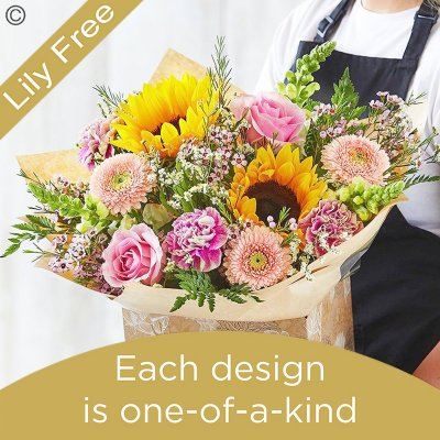 Lily Free Florists Choice Hand tied bouquet made with seasonal flowers Code: LFHT6S | National Delivery and Local Delivery Or Collect From Shop