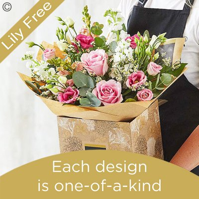 Lily Free Florists Choice Hand tied bouquet made with seasonal flowers Code: LFHT3S | National Delivery and Local Delivery Or Collect From Shop