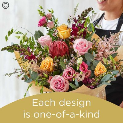 Lily Free Florists Choice Hand tied bouquet made with seasonal flowers Code: LFHT8S | National Delivery and Local Delivery Or Collect From Shop