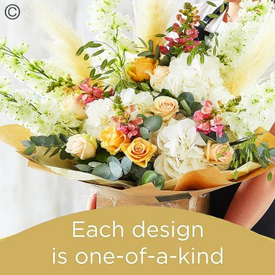 Lily Free Florists Choice Hand tied bouquet made with seasonal flowers Code: LFHT11S | National Delivery and Local Delivery Or Collect From Shop