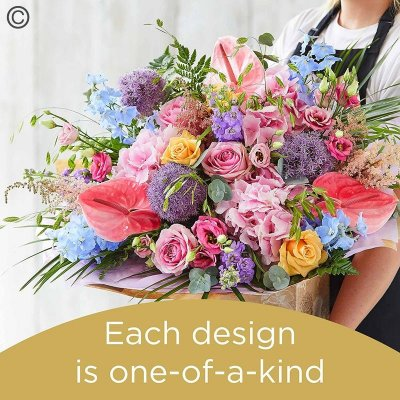 Lily Free Florists Choice Hand tied bouquet made with seasonal flowers Code: LFHT12S | National Delivery and Local Delivery Or Collect From Shop