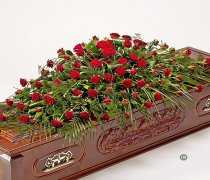 Red Rose Casket Spray Code: JGFF90854CS  | Local Delivery Or Collect From Shop Only